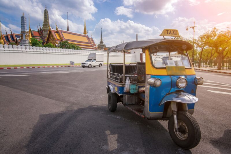 Tuk Tuk is parking in front of Wat Phra Kaeo or Grand Palace, Bangkok, Thailand.